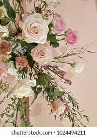 Vertical image of image of white rose and pink flowers on pink wall for background pastels concept