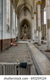 A vertical interior view of the sanctuary sans the pews and ornamentation at a long closed and abandoned church.