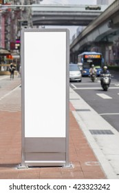 Vertical Isolated blank billboard on the city street,Cityscape blank billboard for the user to modify. Advertising in blank,selective focus,vintage color