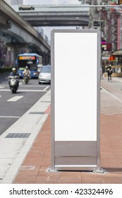 Vertical Isolated blank billboard on the city street,Cityscape blank for the user to modify. Advertising in blank,selective focus,vintage color
