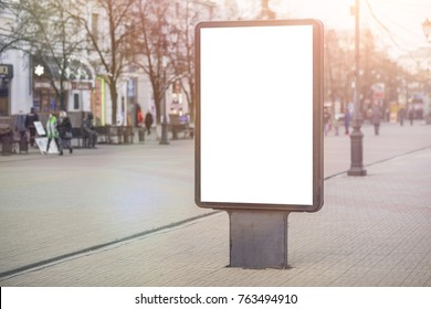 Vertical Isolated blank billboard on the city street. Mock up. for your advertising design
