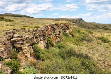 Vertical landscape photograph of bison cliffs at head smashed in buffalo jump  in Alberta, Canad