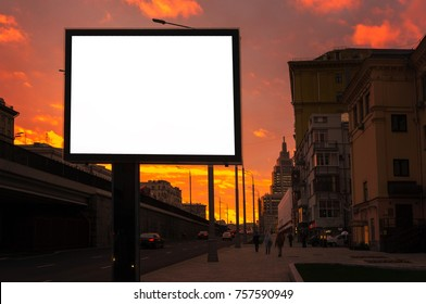 vertical light box, billboard plate on the background of a road at night in sunset,