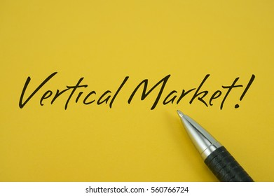 Vertical Market! note with pen on yellow background