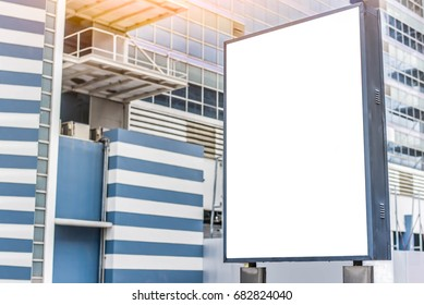 Vertical mock-up of city poster with thick edges, blank white billboard in urban settings,information placeholder on sidewalk with copy space for logo, advertising or your messages