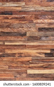 Vertical mosaic, texture and background of old wooden slats, wooden planks. Brown slats, planch, bred wall. Vintage rustic close-up wood texture.