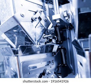 Vertical multi-head weigher packaging machine snacks and chips in a factory