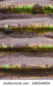 vertical orientation color image close up of a textured railway car