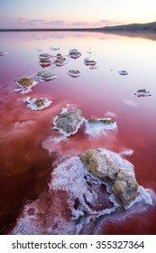 Vertical panorama of stones on Koyashskoe pink salt lake (firth) in Crimea