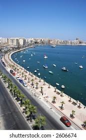 Vertical panorama view of promenade and bay in Sliema, Malta.