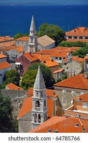 vertical photo of ancient town of Zadar with two church towers, Croatia