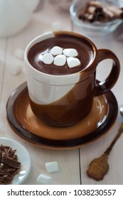 Vertical photo of a brown mug of hot chocolate with marshmallow