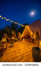 Vertical photo with glamping tent and moon