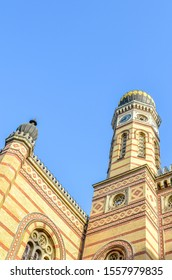 Vertical photo of the Great Synagogue in Budapest, Hungary. Known also as Dohany Street Synagogue, the largest synagogue in Europe. Centre of Neolog Judaism. Ornamental facade and a onion dome.