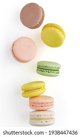 Vertical photo of Macaroon. Colorful cake macaron with pastel tones fall at the stack macaroon on white background. Top view of almond cookies