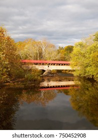 Vertical photogrpah of the Academia Pomeroy Covered Bridge, across the Tuscarora River in Juniata County, Pennsylvania, on an autumn day.