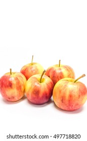 vertical picture of group of five fresh colorful apple isolated on white background