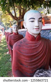 Vertical picture of monks statues, symbol of Offering at Kaw Ka Thaung Cave, located close to Hpa-An, Myanmar
