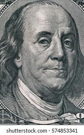 Vertical portrait of Benjamin Franklin's face on the US 100 dollar bill. Macro shot.