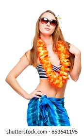 Vertical portrait of brunette in floral lei and bikini on white background