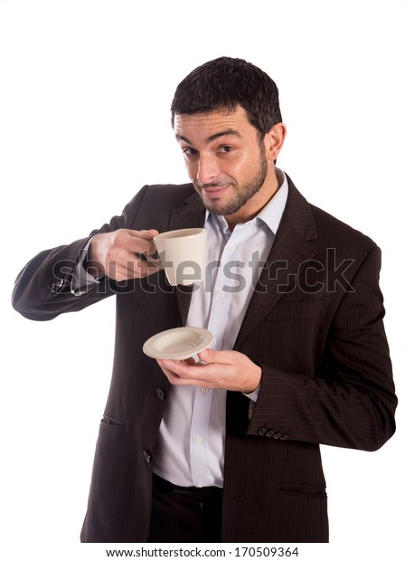 vertical portrait of a business man wearing a suit drinking coffee looking at the camera