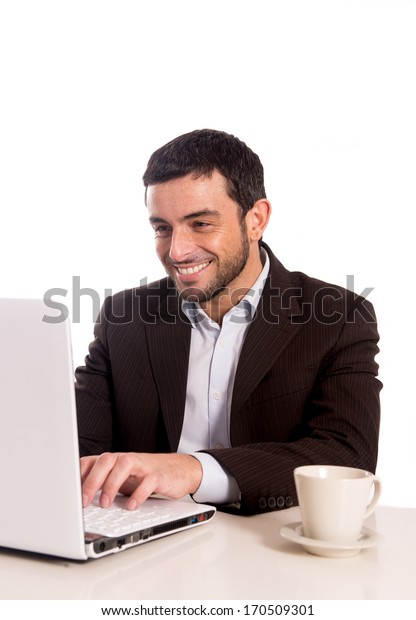 vertical portrait of a happy business man concentrating on a laptop on a white background.