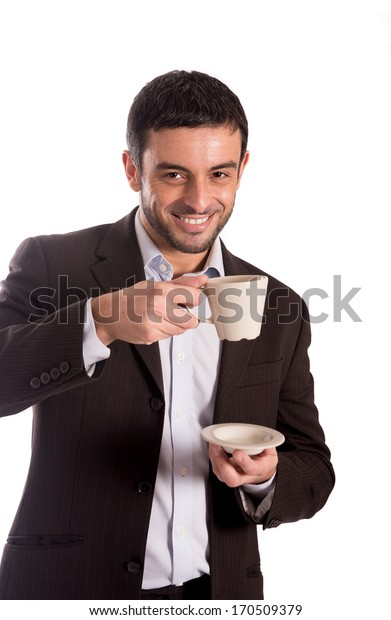 vertical portrait of a happy business man wearing a suit drinking coffee looking at the camera with copyspace