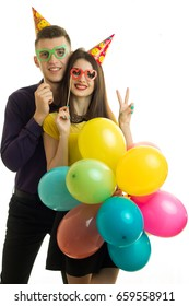 vertical portrait of happy young couple on birthday party