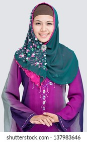 Vertical portrait of a muslim girl in traditional wearing