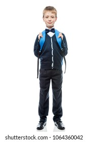 vertical portrait of a schoolboy with a backpack in the form in full length isolated