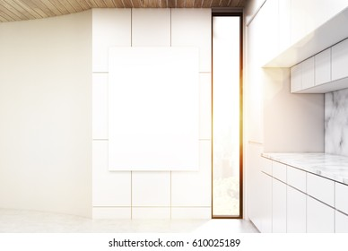 Vertical poster is hanging on a kitchen wall. There is a white counter to the right. A narrow window. 3d rendering, mock up, toned image