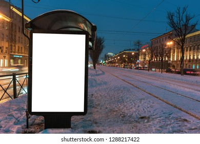 vertical poster. outdoor advertising in the evening. stand for advertising mockup at the tram stop