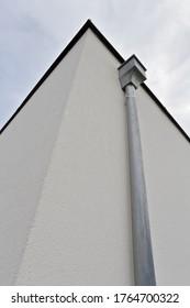 vertical rainwater pipe of a modern villa