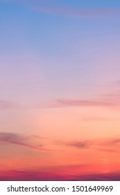 Vertical ratio size of sunset background. sky with soft and blur pastel colored clouds. gradient cloud on the beach resort. nature. sunrise.  peaceful morning. Instagram toned style