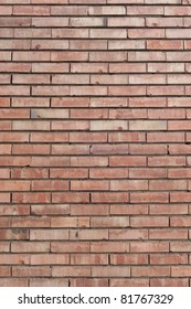 Vertical red brick wall texture.