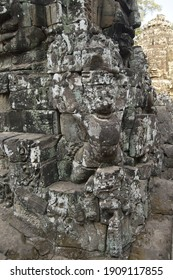 A vertical shot of ancient bas-relief in Angkor Wat temple, Cambodia