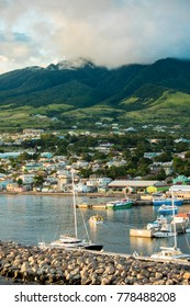 Vertical shot of Basseterre, St Kitts with Mt Liamuiga in the background.