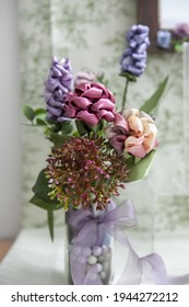 A vertical shot of a beautiful decorative composition with various artificialflowers