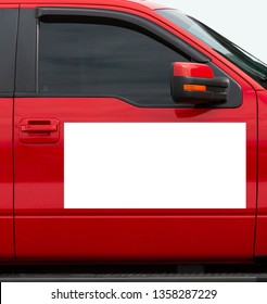 Vertical shot of a blank white magnetic sign on a red car's passenger side door.