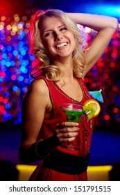 Vertical shot of a blonde girl having a good time at the party