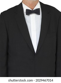 A vertical shot of a caucasian man wearing a suit with a bowtie