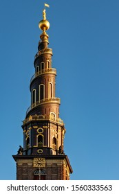 A vertical shot of the Church of Our Saviour under the blue sky captured in Copenhagen, Denmark