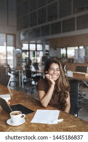 Vertical shot delighted carefree charming female entrepreneur take break drink coffee laughing happily smiling talking coworker studying co-working cafe, freelancing use laptop, study papers