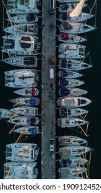 A vertical shot of different yachts near the harbor