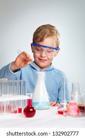 Vertical shot of an enthusiastic school guy being happy about successful experiment