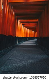 Vertical shot of famous Tori Gates in Fushimi Inari with photo filter applied