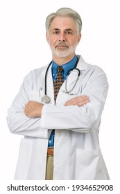 Vertical shot of a friendly older male family doctor standing with his arms crossed and wearing a white lap coat with a stethoscope around his neck.  This is a revised image.