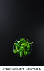 A vertical shot of green leaves canonigos and rucula, to make salads