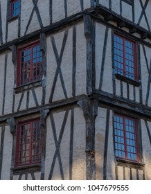 A vertical shot of a half-timbered house in the square Place des Halles in Niort.