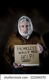 Vertical Shot Of Homeless Man Holding Sign Needing Help/ Homeless Man